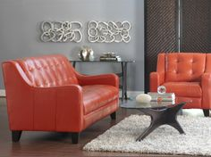 Dania Furniture - Petala Leather Sofa - Tangerine. yeah, that looks comfortable. just what what you want to sit in...bowling shoe scraps pasted together into a couch.