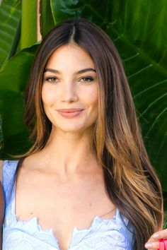 Aldrige's dyed ends frame her face beautifully and add to her beach babe glow (the tropical leaves behind her don't hurt either). - MarieClaire.com
