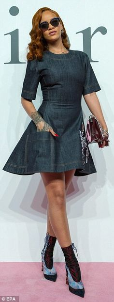 Head to toe: Rihanna added lace-up boots and a printed, chain-length bag from Dior to finish off her look