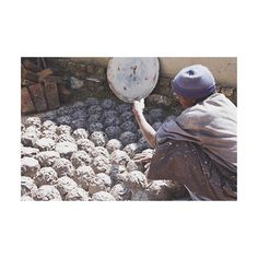 Pottery artisan separating his clay before creating more pots. //