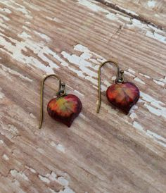 A personal favorite from my Etsy shop https://www.etsy.com/listing/248893884/autumn-leaf-earrings-hand-painted-leaf