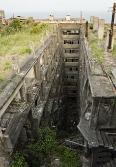 Hashima Island also called Battleship Island is an abandoned coal mining facility and city off the coast of Japan near Nagasaki. Abandoned Buildings, Abandoned Mansions, Old Buildings, Abandoned Places, Places Around The World, Around The Worlds, Hashima Island, Post Apocalypse, Haunted Places