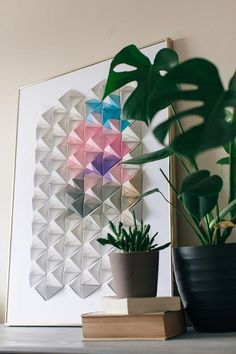 As a paper artist, I am constantly experimenting with new ways to use origami that showcase the essence of Japanese aesthetics. This framed modular origami wall display is a unique and striking way of