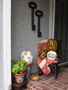 my Thanksgiving Porch w/ painted pumpkins :)