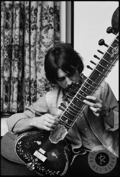 "thateventuality: "" George Harrison playing his sitar at Kinfauns, Esher, 1967 Photo: Henry Grossman """"Another time, Grossman was at Harrison's house, and saw what he assumed was a wall decoration. 'I said, ""What's that?""' Grossman remembers. 'He..."