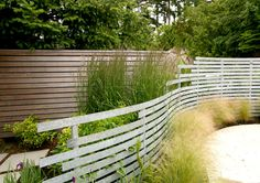 dig the look of the fence breaking apart as it goes from a physical barrier to a visual barrier