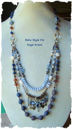 Boho Style Multi-Strand Blue by BohoStyleMe. joins at faceted, brass wrapped clear crystals. Gemstones, rustic earthy clay beads, freshwater pearls, coral, shell, and crystals. Picasso finished glass, Czech glass, 3 glass flowers throughout. Strand of blue frosted teardrops, floral antique brass component holding an array of Boho gypsy bead, pearl & charm, dangles. Antique brass beads, findings & brass wire.   Length – Shortest strand 24 inches, longest 34 inches.