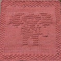 Elephant No. 1 Knit Dishcloth Pattern  This knit dishcloth picture is of an elephant facing forward. His ears are fanned outward and his trunk swings out to the right. He is a nearly solid design with some spaces to suggest the ears, eyes and trunk.