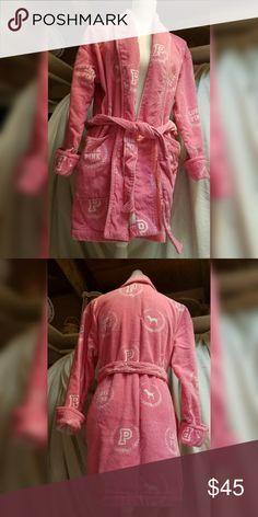 "UNIVERSITY OF PINK ROBE Pink with  white ""P"" and dog logo. Has belt. 100% COTTON EUC. 32"" back of neck to hem. Drop shoulder 22"" to wrist, 2 front pockets, 49"" around; 69"" belt. Victoria's Secret Intimates & Sleepwear Robes"