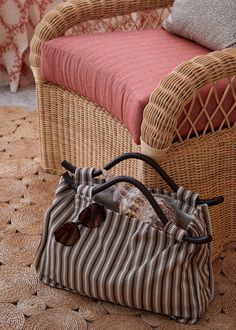 Soane Britain's Rattan Lily Armchair shown in the Colleton Suite, Cobblers Cove Hotel Circular Table, Chair Backs, Rattan, Britain, Straw Bag, Hand Weaving, Armchair, Lily, Bags