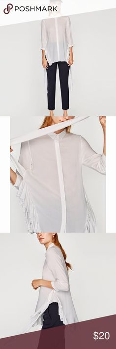 Zara Blouse with Ruffled Hem Blouse with lapel collar and long sleeves. Features double cuffs, asymmetrical hemline with ruffles, bow detail in back and button up fastening in the front. Zara Tops Blouses