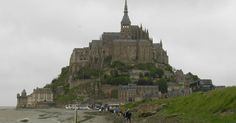 Perched on a rocky islet in the midst of vast sandbanks exposed to powerful tides between Normandy and Brittany stand the 'Wonder of the West', a Gothic-style Benedictine abbey dedicated to the archangel St Michael,  ...