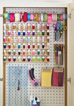 For inconspicuous storage, hang a piece of pegboard on the inside of a closet door to organize your craft supplies. Add a bar to store ribbon and small baskets to hold rulers, scissors, and marking tools.