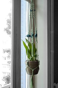 Hanging planter macramé cotton mint green, deep green pearls and little dinosaurs. Chic-bohemian decor, height 1 m, hanger system for plants