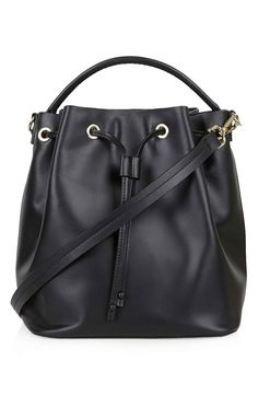 This versatile leather handbag comes with a cinchable drawstring closure and a removable crossbody strap for different styling options.