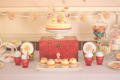 Sweet Shoppe - love the little red glasses, the gum ball machines, and the pom pom garland.