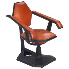 "[Treadway - Toomey Galleries] - Arts and Crafts, 50s, Art Nouveau, Rookwood Pottery and paintings - Important Frank Lloyd Wright chair, designed for Price Tower, Bartlesville, Oklahoma, 1952-1956, painted black cast aluminum base with original leather seat and back, one of 40 made, designed as a ""casual chair,"" the sloping arms and fixed back were ""intended to correct posture,"" 29""w x 24""d x 33""h, excellent condition, a great example of this iconic form"