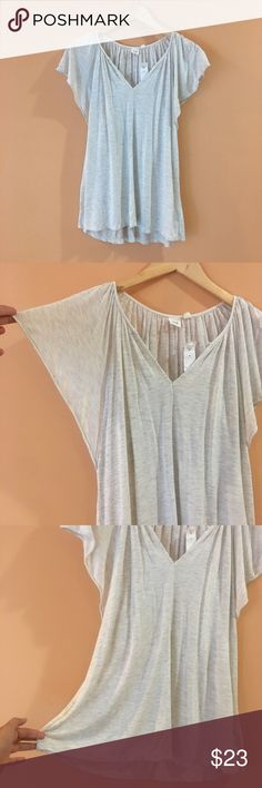 "NWT GAP Heather Gray Swing Top NWT GAP Heather Gray Swing Top. V Neck. Pit to pit 20""/ front length 26""/ back 27"". GAP Tops"