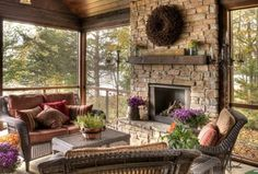 Rustic Porch with Wicker furniture, Iron Candelabra by Privilege, Wrap around porch, stone fireplace