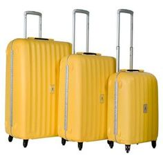 """Jetset in style with this timeless 3-piece luggage set, featuring 360-degree wheels and push-button retractable handles.  Product: Small, medium and large suitcaseConstruction Material: Aluminum and polpropyleneColor: YellowFeatures:  Lined interior with mesh zippered pocket and two extra compartmentsTSA approved lock systemDimensions: Small: 22"""" H x 14"""" W x 9"""" DMedium: 26"""" H x 18"""" W x 10"""" DLarge: 30"""" H x 20"""" W x 12"""" D"""