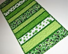 """St. Patrick's Day Quilted Table Runner, Shamrock Table Mat, Scrappy Strips Table Runner, Green and White, 30""""x12"""", Quiltsy Handmade by VillageQuilts on Etsy"""