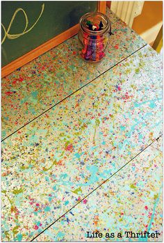 .Going to do this to my craft desk. shredded crayons then use a hair dryer to melt them and cover with a layer of polyurethane
