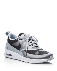 In cool, monochrome camo print, Nike's low-cut sneakers offer understated style with the signature comfort of Air Max technology.   Textile, synthetic and leather upper, textile lining, EVA sole   Imp