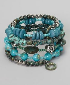Loving this Turquoise Beaded Coil Stretch Bracelet on #zulily! #zulilyfinds