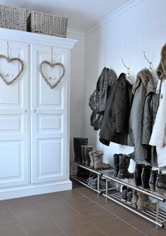 entry way - shoe rack and command hooks for jackets.