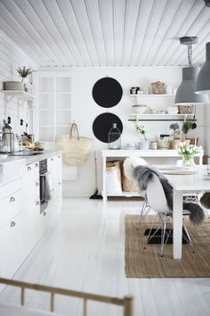 A true tinekhome kitchen. Light and personal with cool dark details.