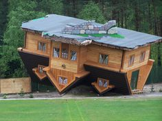 Upside Down House, Szymbark, Poland -  Constructed in 2007 the house was designed by Polish businessman and philanthropist Daniel Czapiewski was designed to be representative of the uncertainty found at the end of the communist era in Poland. The house situated in northern Poland attracts thousands of tourists each year. The house took approximately five times longer than a conventional house to construct due to the disorientation the workers felt while constructing.