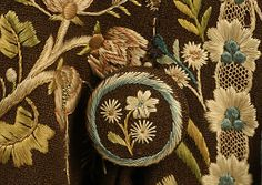 Detail button, coat, America or Europe, 17th century. Brown wool embroidered with naturalistic floral motifs in multicoloured silk.