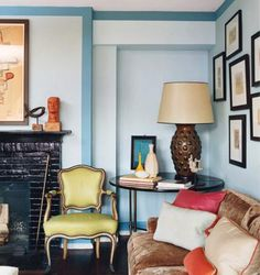 In his living room, interior designer Steven Gambrel used a 3-inch dark blue border to make the ceiling appear higher -- a modern spin on crown molding. Walls are Winter Sky #14-4307 TPX; border is Niagara #17-4123 TPX, both by Pantone Paints.