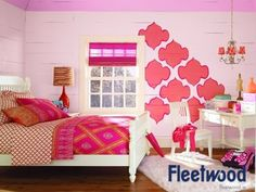 A girly bedroom painted with Fleetwood Paints. Wall - Soft Pink from the Popular Colours range. Border - Pink Popsicle from the Cool Colours range. Stencil - Glee from the Cool colours range.