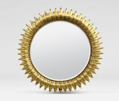 """""""Bella"""" sunburst mirror by MadeGoods has two layers of rays that are similar to laurel leaves. It reminds me of some of Line Vautrin's mirrors. Gold leaf on the rays. Available in 28"""" and 18"""" sizes."""