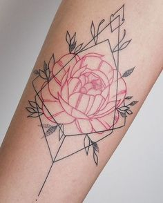 Red rose and black ornament tattoo on the arm