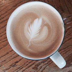 Looking for a beautiful latte in Seattle? Visit Irwin's Neighborhood Bakery and Cafe. They are pulling beautiful #bluestarcoffee shots and foaming that perfect foam. #irwinsbakery #wallingford #seattlecoffee #latteart