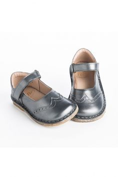 Sure to be a seasonal favorite, these classic steel grey leather Mary Jane shoes feature a scalloped dot cutout design, easy Velcro straps, and durable rubber soles. By Pepe.