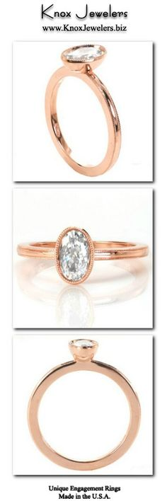 This delicate solitaire engagement ring design features a bezel set oval center diamond. The bezel is set up on top of the band to allow for a straight wedding band to sit flush next to the design. The edge of the bezel and the edges of the band are detailed with a small beaded texture called milgrain. Click on pin for information about ring and our interest free financing.
