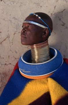 Ndebele Woman in Traditional Dress. izigholwani and ingholwani, thick grass rings covered with beads and an ingubo, the colorful blanket worn by married women. African Life, African Culture, African Women, African Beauty, Tribal Women, Tribal People, We Are The World, People Around The World, Tribal Fashion