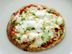 Spread a round of pita bread with tomato paste and herbs. Top with tomato, ham, mortadella, onion, sliced mushrooms, or pineapple. Sprinkle with grated low-fat hard cheese and grill to make a tasty mini pizza