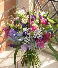 English Country Garden Wedding Bouquet. I love this bouquet from August 2015, so many colours and flower varieties.  Not one flower dominates this bouquet, which creates a just picked from the meadow feel.