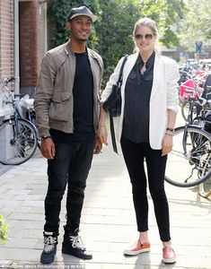 Dynamic duo: The couple looked jovial chatting together outside their home in Amsterdam in the Netherlands on Tuesday