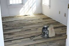 Wood flooring from recycled pallets! Oh, yes! I think we will be looking into this for the living area...to go with our wood wall!