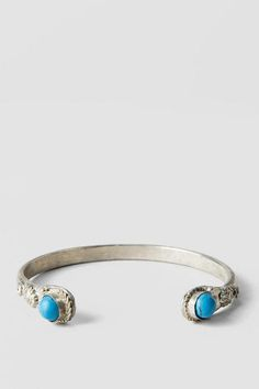 """Rough silver is embellished with turquoise stones to create a cute rustic look <br><br>  - 1.75"""" width<br> - Lead & nickel free<br> - Imported<br>"""
