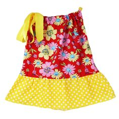 A cute pillowcase dress by Dress Up Dreams Boutique will make your girl look fabulous and feel comfy on hot summer days. The dress features pink, yellow and blue flowers on a field of red on bodice and yellow polka dots on trim. It has a satin drawstring
