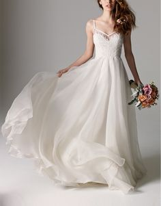 Lovely lace and delicate silk organza elevate this dreamy gown to fairy tale romance.