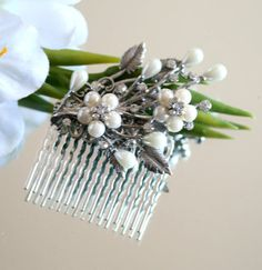 """Lovely handmade wedding hair comb is perfect for your big day.  I took vintage filigree, added leaves and a gorgeous vintage inspired silver and white brooch that includes with crystal rhinestones.     * 2.5 inches high at the tallest point,including the comb  * 1.75 inches across   * Weighs less than 1 oz  * The beads are luster beads in a off white color  * The Silver metal comb is lead free  * I will send USPS Priority Mail in the USA.     """"The perfect way to wear something old and…"""
