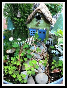 fairy garden with mushroom decorations theme 614x800 Miniature Gardens News Articles and Photos from Around the Web 6 18 2012