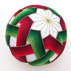 The artful geometry of Japanese temari thread balls, a traditional Japanese craft in which colored thread is applied to a sphere in a geometric pattern.